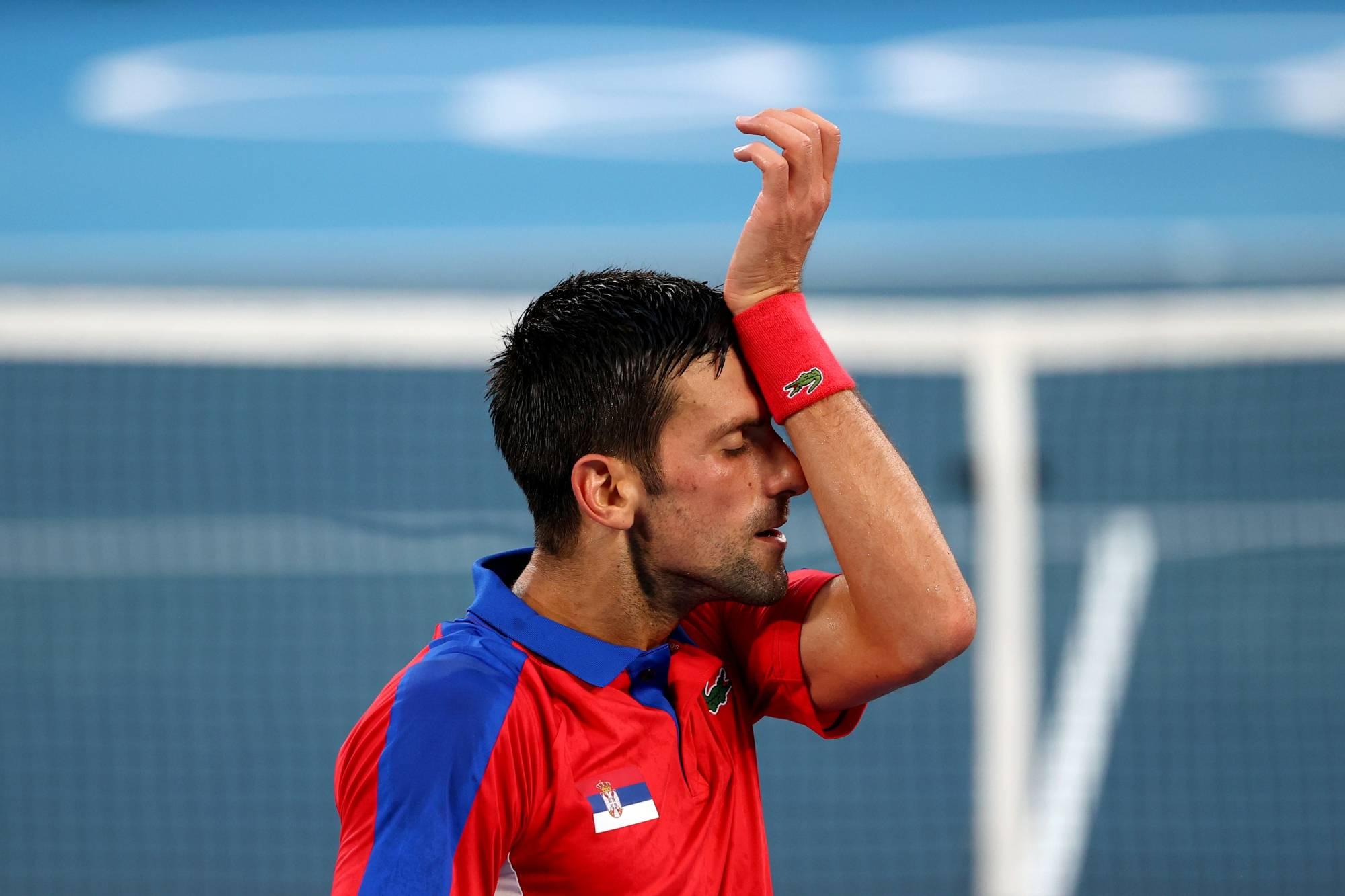 Novak Djokovic loses to Pablo Carreno Busta in bronze-medal match