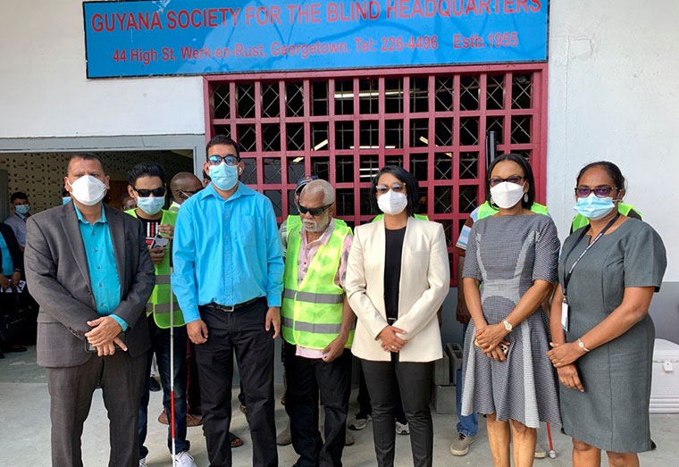 Visually impaired block-makers being trained