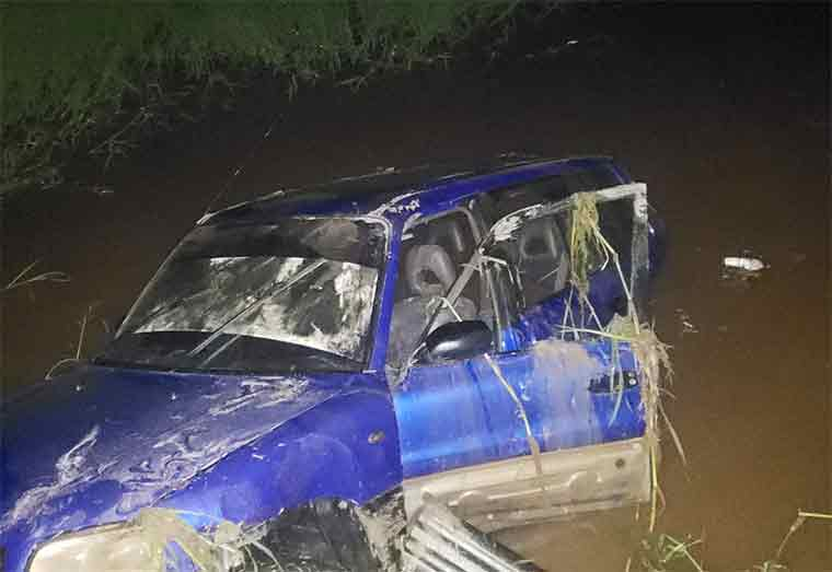 Two dead as car plunges into trench